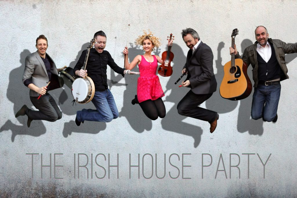 Irish musicians jumping in the air